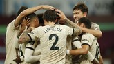 Manchester United's Paul Pogba, obscured, is congratulated by teammates after scoring his team's third goal during the English Premier League soccer match between Aston Villa and Manchester United at Villa Park in Birmingham, England, Thursday, July 9, 2020. (AP PhotoAndrew Boyers,Pool)