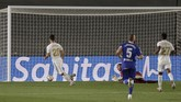 Real Madrid's Marco Asensio, left, scores during the Spanish La Liga soccer match between Real Madrid and Deportivo Alaves at the Alfredo di Stefano stadium in Madrid, Spain, Friday, July 10, 2020. (AP Photo/Bernat Armangue)