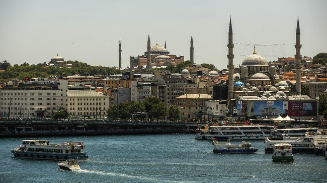 The Byzantine-era Hagia Sophia, one of Istanbul's main tourist attractions in the historic Sultanahmet district of Istanbul, is seen, top center, Saturday, July 11, 2020. Turkey's President Recep Tayyip Erdogan formally reconverted Hagia Sophia into a mosque and declared it open for Muslim worship, hours after a high court annulled a 1934 decision that had made the religious landmark a museum.The decision sparked deep dismay among Orthodox Christians. Originally a cathedral, Hagia Sophia was turned into a mosque after Istanbul's conquest by the Ottoman Empire but had been a museum for the last 86 years, drawing millions of tourists annually. (AP Photo/Emrah Gurel)