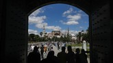 People walk towards the now closed Byzantine-era Hagia Sophia, one of Istanbul's main tourist attractions in the historic Sultanahmet district of Istanbul, Saturday, July 11, 2020. Turkey's President Recep Tayyip Erdogan formally reconverted Hagia Sophia into a mosque and declared it open for Muslim worship, hours after a high court annulled a 1934 decision that had made the religious landmark a museum.The decision sparked deep dismay among Orthodox Christians.  (AP Photo/Emrah Gurel)