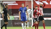 Sheffield United's David McGoldrick, right, celebrates after scoring his side's opening goal during the English Premier League soccer match between Sheffield United and Chelsea at Bramall Lane in Sheffield, England, Saturday, July 11, 2020. (AP photo/Rui Vieira, Pool)