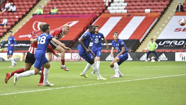 Sheffield United's Oliver McBurnie, fourth right, scores his side's second goal during the English Premier League soccer match between Sheffield United and Chelsea at Bramall Lane in Sheffield, England, Saturday, July 11, 2020. (Peter Powell/Pool via AP)