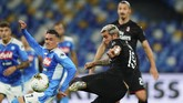 AC Milan's Theo Hernandez scores a goal against Napoli during a Serie A soccer match at San Paolo Stadium in Naples, Italy, Sunday, July 12, 2020. (Spada/LaPresse via AP)