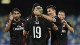 AC Milan's Theo Hernandez (10) is congratulated after a goal against Napoli during a Serie A soccer match at San Paolo Stadium in Naples, Italy, Sunday, July 12, 2020. (Spada/LaPresse via AP)