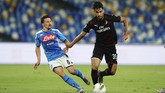 AC Milan's Lucas Paqueta, right, keeps the ball from Napoli's Mario Rui during a Serie A soccer match at San Paolo Stadium in Naples, Italy, Sunday, July 12, 2020. (Spada/LaPresse via AP)