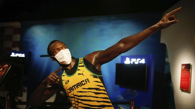 In order to raise awareness against the spread of the coronavirus, a mask is placed on the wax figure of Jamaica's Usain Bolt at Madame Tussauds attraction in Istanbul, Saturday, July 11, 2020. Turkish authorities have made the wearing of masks mandatory in most of the country to curb the spread of COVID-19 following an uptick in confirmed cases since the reopening of many businesses. (AP Photo/Emrah Gurel)