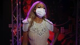 In order to raise awareness against the spread of the coronavirus, a mask is placed on the wax figure of Beyonce at Madame Tussauds attraction in Istanbul, Saturday, July 11, 2020. Turkish authorities have made the wearing of masks mandatory in most of the country to curb the spread of COVID-19 following an uptick in confirmed cases since the reopening of many businesses. (AP Photo/Emrah Gurel)