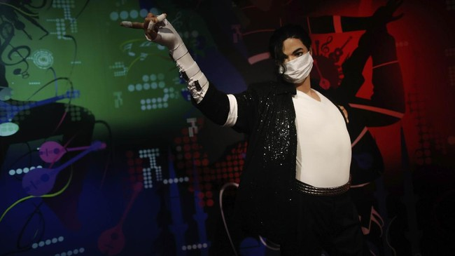 In order to raise awareness against the spread of the coronavirus, a mask is placed on the wax figure of Michael Jackson at Madame Tussauds attraction in Istanbul, Saturday, July 11, 2020. Turkish authorities have made the wearing of masks mandatory in most of the country to curb the spread of COVID-19 following an uptick in confirmed cases since the reopening of many businesses. (AP Photo/Emrah Gurel)
