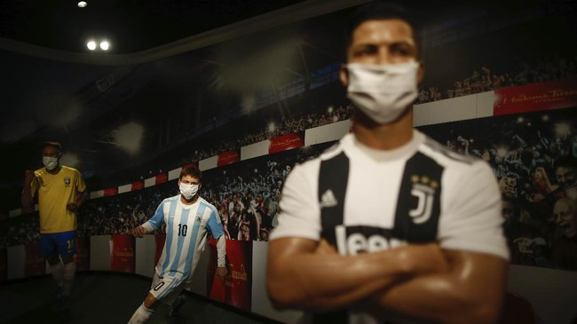 In order to raise awareness against the spread of the coronavirus, masks are placed on the wax figures of star football players, Brazil's Neymar, left, Argentina's Lionel Messi, center, and Portugal's Cristiano Ronaldo, right, at Madame Tussauds attraction in Istanbul, Saturday, July 11, 2020. Turkish authorities have made the wearing of masks mandatory in most of the country to curb the spread of COVID-19 following an uptick in confirmed cases since the reopening of many businesses. (AP Photo/Emrah Gurel)