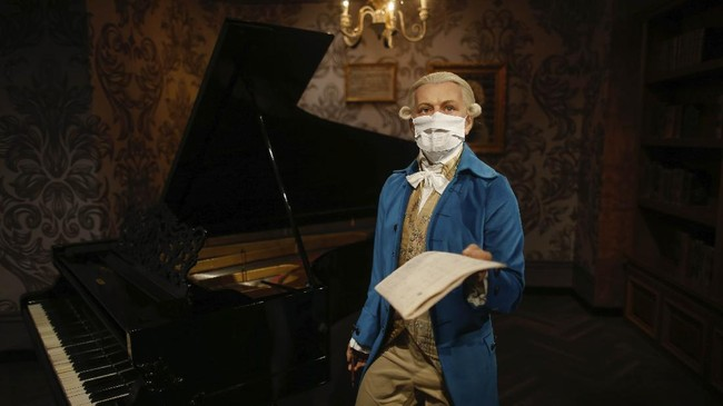 In order to raise awareness against the spread of the coronavirus, a mask is placed on the wax figure of Wolfgang Amadeus Mozart at Madame Tussauds attraction in Istanbul, Saturday, July 11, 2020. Turkish authorities have made the wearing of masks mandatory in most of the country to curb the spread of COVID-19 following an uptick in confirmed cases since the reopening of many businesses. (AP Photo/Emrah Gurel)