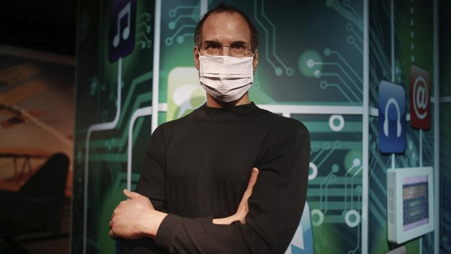 In order to raise awareness against the spread of the coronavirus, a mask is placed on the wax figure of Apple founder Steve Jobs at Madame Tussauds attraction in Istanbul, Saturday, July 11, 2020. Turkish authorities have made the wearing of masks mandatory in most of the country to curb the spread of COVID-19 following an uptick in confirmed cases since the reopening of many businesses. (AP Photo/Emrah Gurel)
