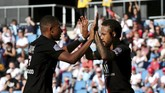 Paris Saint Germain's Neymar, right, celebrates with teammate Kylian Mbappe after he scored a goal during a friendly soccer match between Paris Saint Germain and Le Havre, in Le Havre, western France, Sunday, July 12, 2020. (AP Photo/Thibault Camus)