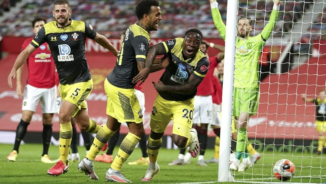 Southampton's Michael Obafemi, 20, celebrates after scoring his team's second goal during the English Premier League soccer match between Manchester United and Southampton at Old Trafford in Manchester, England, Monday, July 13, 2020. (AP Photo/Dave Thompson,Pool)