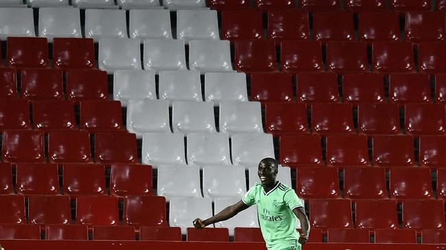 Real Madrid's Ferland Mendy celebrates after scoring the opening goal during the Spanish La Liga soccer match between Granada and Real Madrid at the Los Carmenes stadium in Granada, Spain, Monday, July 13, 2020. (AP Photo/Jose Breton)