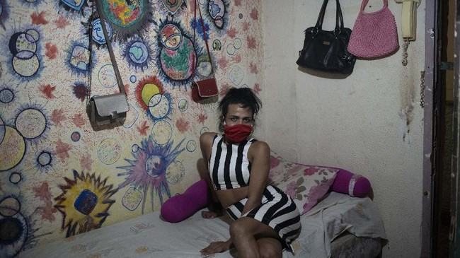 Venezuelan transgender Vanessa poses for a photo inside her room at the squat known as Casa Nem, occupied by members of the LGBTQ community who are in self-quarantine as a protective measure against the new coronavirus, in Rio de Janeiro, Brazil, Saturday, May 23, 2020. (AP Photo/Silvia Izquierdo)
