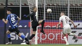 Torino's Andrea Belotti, right, scores his side's opening goal during a Serie A soccer match between Inter Milan and Torino, at the San Siro stadium in Milan, Italy, Monday, July 13, 2020. (AP Photo/Luca Bruno