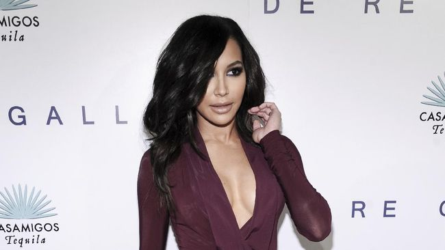 "FILE - Actress Naya Rivera arrives at the opening of photographer Brian Bowen Smith's WILDLIFE in West Hollywood, Calif., on Oct. 23, 2014. Authorities say the former ""Glee"" star is missing and being searched for at a Southern California lake. Rivera played Santana, a cheerleader in the musical-comedy ""Glee"" that aired on Fox from 2009 until 2015. (Photo by Richard Shotwell/Invision/AP, File)"