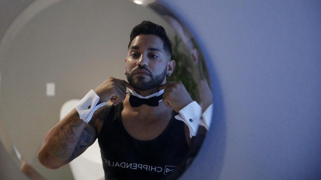 Chippendales dancer Miguel Rivera prepares for a virtual Zoom party from his home Friday, June 19, 2020, in Las Vegas. Rivera is one of a few Chippendale dancers doing virtual shows while the live show is shut down due to the coronavirus. (AP Photo/John Locher)