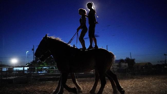 Lisa Varmbo Martonovich, left, and Nicole England-Czyzewski practice roman riding on two horses for