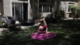 Hand balancer Nataliia Istratova works out on a mat behind her apartment Saturday, June 20, 2020, in Henderson, Nev.
