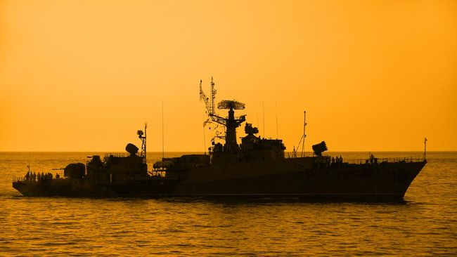 silhouette of a warship at sunset