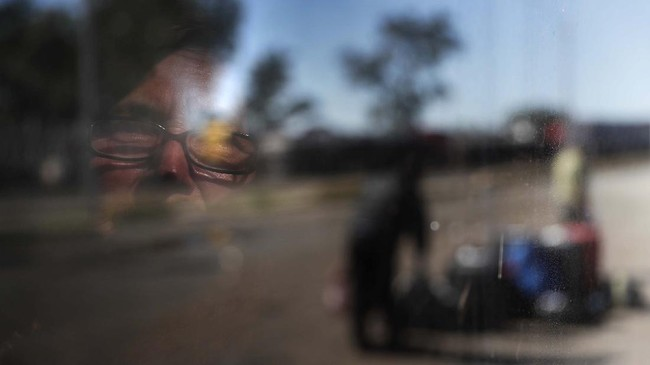 An elderly Paraguayan looks out the window of a specially organized bus that took people from Buenos Aires, Argentina, to the border town of Puerto Falcon, Paraguay, where the border is closed as a measure to curb the spread of COVID-19, Friday, July 10, 2020. Many on the bus were elderly Paraguayans returning home after getting stuck in Argentina where they were visiting relatives at the start of the lockdown. The travelers will quarantine in a government-run shelter in Paraguay before being allowed to continue to their homes. (AP Photo/Jorge Saenz)