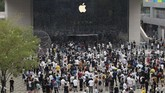 Apple fans cheer as the doors to a new flagship store are opened at Sanlitun in Beijing, China on Friday, July 17, 2020. China's economy rebounded from a painful contraction to grow by 3.2% over a year earlier in the latest quarter as anti-virus lockdowns were lifted and factories and stores reopened. (AP Photo/Ng Han Guan)