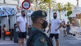 Guardia Civil officers stand guard on the street at the resort of Magaluf, in Punta Ballena town, on the Spanish Balearic island of Mallorca, Spain, Wednesday, July 15, 2020. Authorities in Spain's Balearic Islands are pulling the plug on endless drunken nights to the beat of techno music by closing bars and nightclubs in beachfront areas popular with young and foreign visitors. (AP Photo/Francisco Ubilla)
