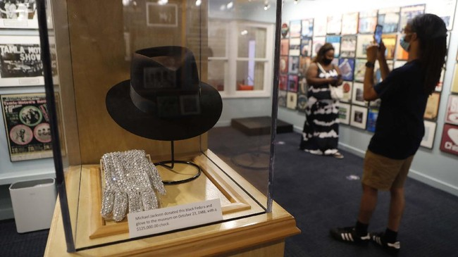 Michael Jackson's black Fedora and glove are displayed at the Motown Museum, Wednesday, July 15, 2020, in Detroit. The Detroit building where Berry Gordy Jr. built his music empire reopened its doors to the public on Wednesday. It had been closed since March due to the coronavirus pandemic. (AP Photo/Carlos Osorio)