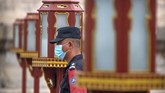 A security officer wearing a face mask to protect against the coronavirus stands guard at the Temple of Heaven in Beijing, Saturday, July 18, 2020. Authorities in a city in far western China have reduced subways, buses and taxis and closed off some residential communities amid a new coronavirus outbreak, according to Chinese media reports. They also placed restrictions on people leaving the city, including a suspension of subway service to the airport. (AP Photo/Mark Schiefelbein)