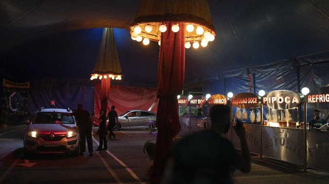 Cars arrive at the Estoril Circus during the coronavirus pandemic in Itaguai greater Rio de Janeiro, Brazil, Saturday, July 18, 2020. Following the measures to curb the spread of the COVID-19, artists of this circus have decided to go back to work in a different way, as a circus drive-in. (AP Photo/Leo Correa)