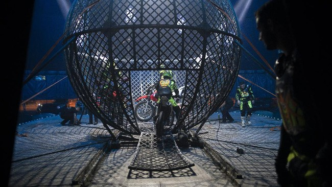 Artists enter the Globe of death on motorcycles at the Estoril Circus despite the coronavirus pandemic in Itaguai, greater Rio de Janeiro, Brazil, Saturday, July 18, 2020. Following the measures to curb the spread of the COVID-19, artists of this circus have decided to go back to work in a different way, as a circus drive-in. (AP Photo/Leo Correa)