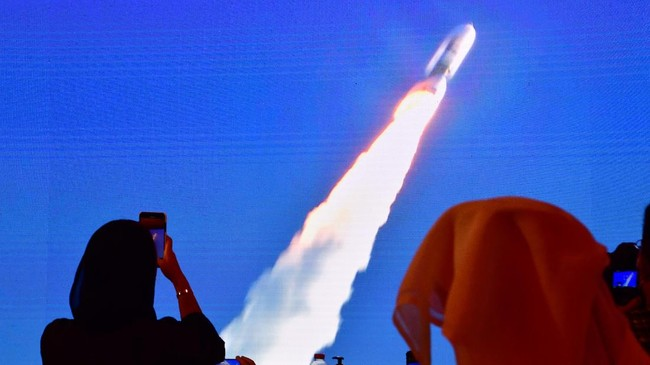 A picture taken on July 19, 2020, shows a screen broadcasting the launch of the