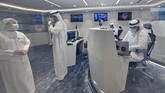 Emirati men are pictured at the mission control center for the
