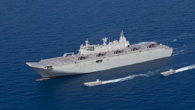 Australia kirimkan kapal terbesar HMAS Canberra gabung AS-Jepang latihan militer di Laut China Selatan buntut ketegangan dengan China.