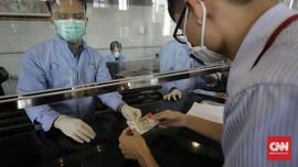Virus Corona Tahan 28 Hari di Uang Kertas dan Layar Ponsel