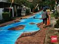 FOTO: 'Sungai' di Tengah Jalan Kampung Basoeki Abdullah