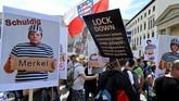 Jerman dilanda aksi unjuk rasa menentang kebijakan lockdown yang dilakukan pemerintah demi menekan penyebaran virus corona.