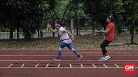 FOTO: Jaga Badan Agar Tak Cedera Saat Olahraga
