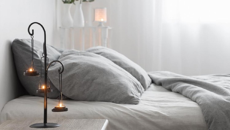 antique candlestick with burning candles in bedroom