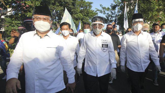 Pemakaman Ketua Tim Pemenangan Machfud Arifin-Mujiaman, Miratul Mukminin atau Gus Amik, dilakukan dengan protokol kesehatan.