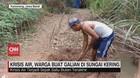 VIDEO: Krisis Air, Warga Buat Galian di Sungai Kering