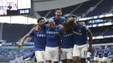 Everton sukses mengalahkan Tottenham di pekan pertama Liga Inggris. Berikut foto-foto pilihan laga tersebut.