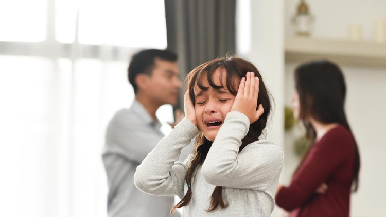 Sadness Little Kid Girl crying and screaming over Couple or her Parent conflicting. Unhappy Family Divorce concept.