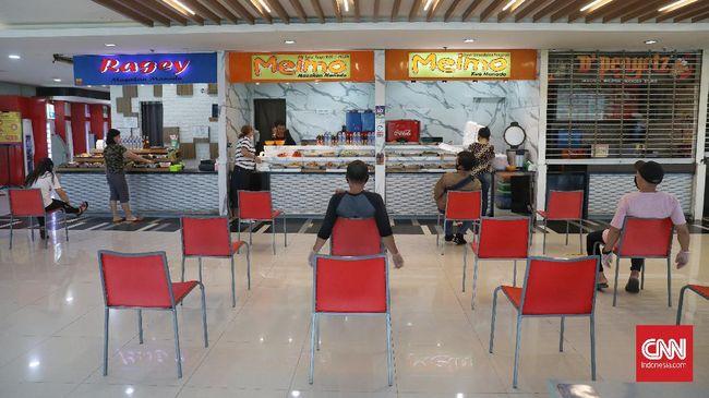 Menko Luhut meminta Gubernur DKI Jakarta Anies Baswedan membatasi jam operasional restoran dan mal hingga pukul 19.00 untuk mencegah penyebaran corona.