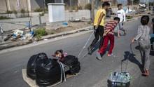 FOTO: Migran Korban Kebakaran di Yunani Pindah ke Kamp Baru