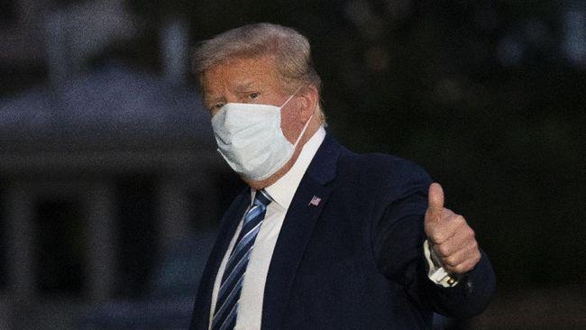 Presiden AS Donald Trump telah diperbolehkan menyelesaikan masa isolasi mandiri. Dia tak lagi berisiko menularkan virus corona pada orang lain.