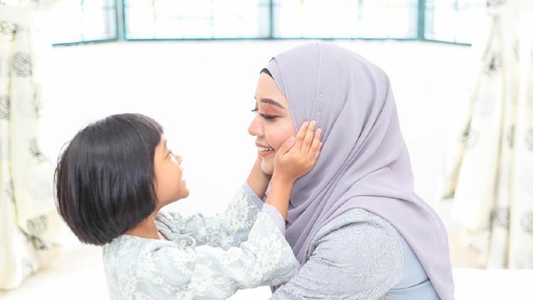 Mother and daughter on Hari Raya Aidilfitri/ Eid-Ul-Fitr in Malaysia.
