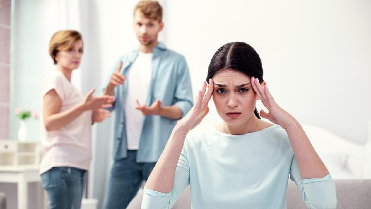 Strong headache. Unhappy depressed woman touching her temples while feeling depressed