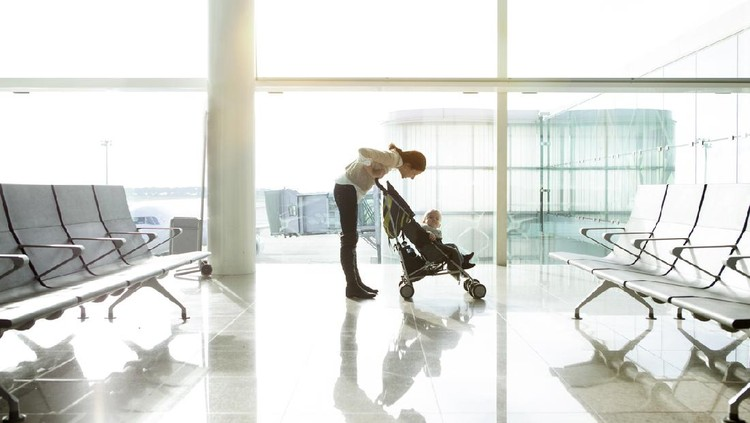 Mother with baby at the airport
